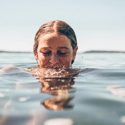 Woman with her head halfway in water