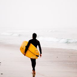 Man carrying surf board